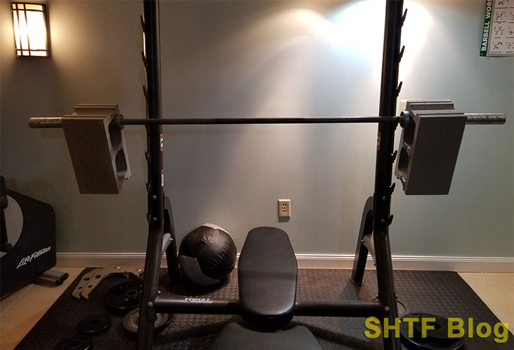 cinder block on barbell weight bench